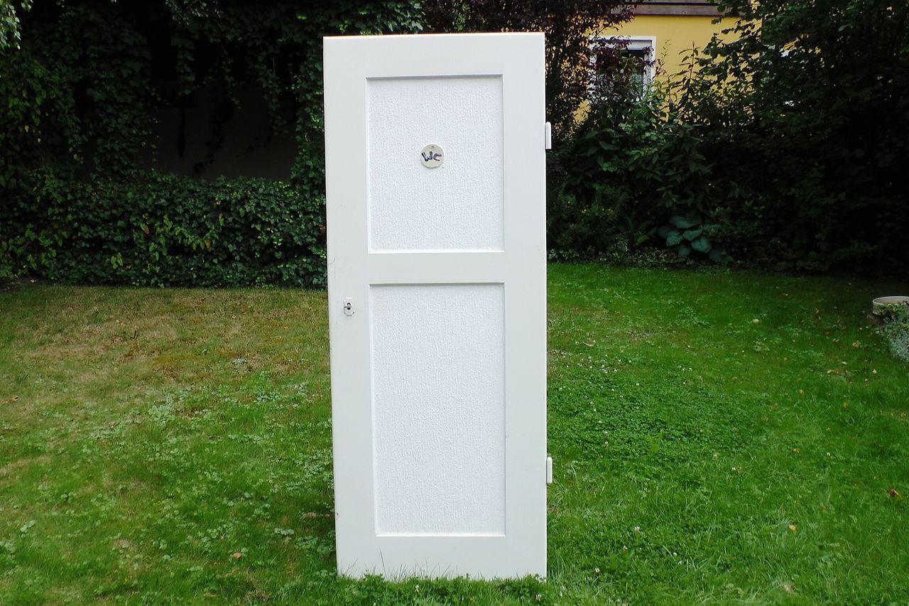 View Of Toilet Door On Grass