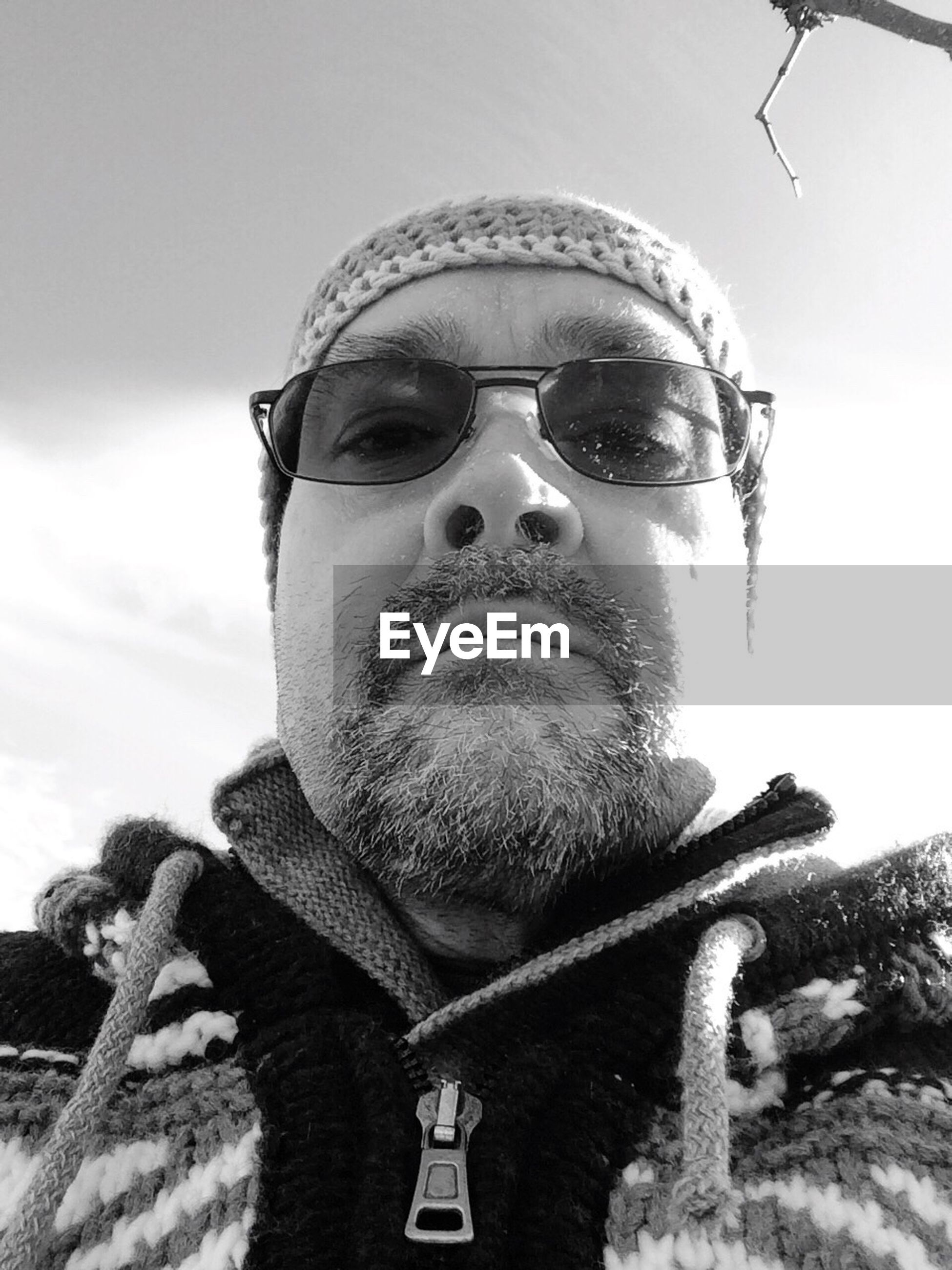 portrait, looking at camera, sunglasses, front view, lifestyles, headshot, young adult, young men, sky, leisure activity, person, cap, winter, beard, close-up, warm clothing, mid adult men, outdoors