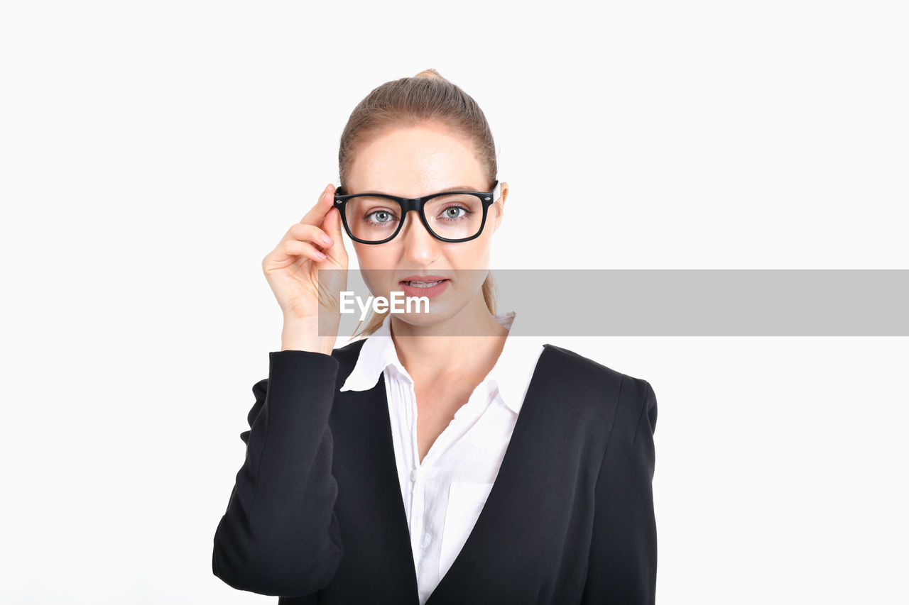 business person, studio shot, front view, white background, portrait, one person, looking at camera, businesswoman, business, young adult, cut out, eyeglasses, headshot, indoors, young women, adult, women, glasses, copy space, beautiful woman