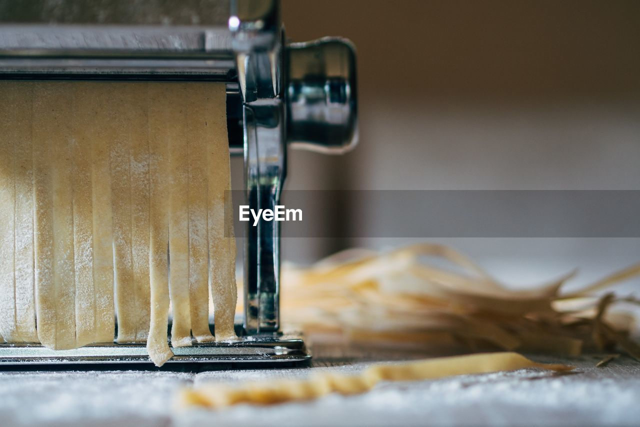 Close-Up Of Pasta Maker On Table
