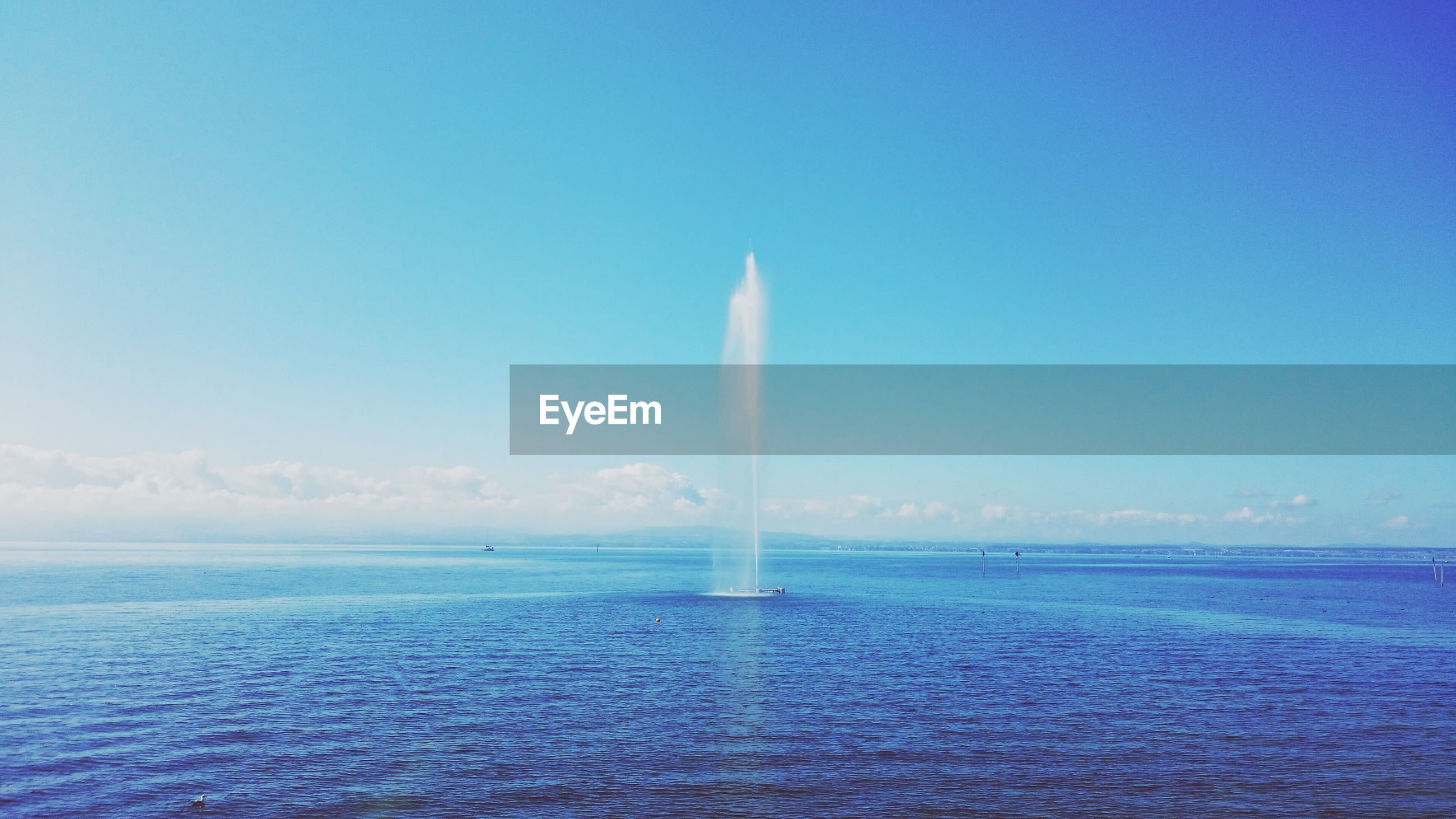 Scenic view of blue lake constance against sky
