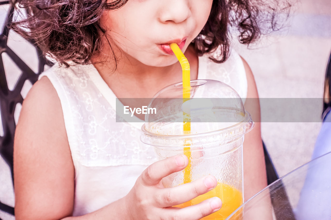 Close-Up Of Girl Having Drink