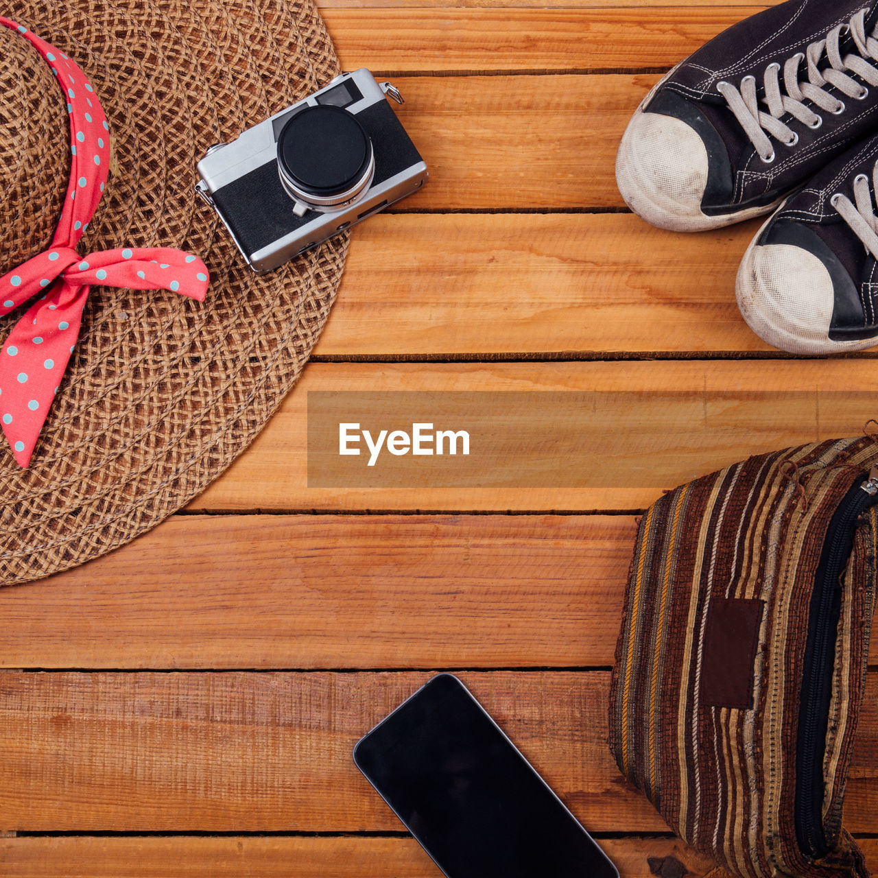 wood - material, indoors, table, still life, high angle view, connection, directly above, technology, no people, shoe, communication, wireless technology, smart phone, glasses, portable information device, wood, mobile phone, brown, close-up, screen, personal accessory