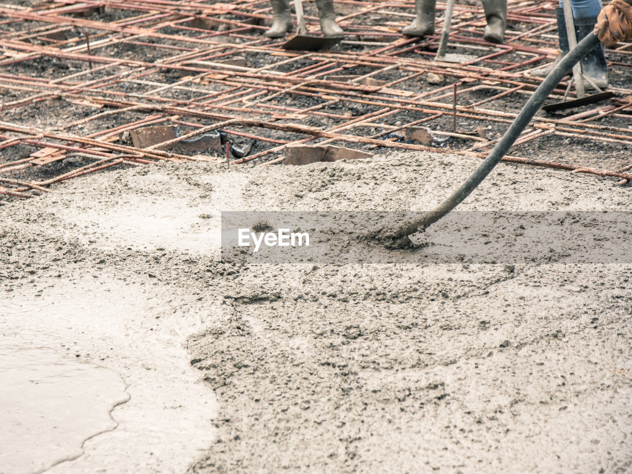 construction industry, construction site, working, industry, road construction, occupation, equipment, day, development, outdoors, construction material, land, human body part, people, architecture, machinery, nature, dirt, repairing, construction equipment, cement, concrete