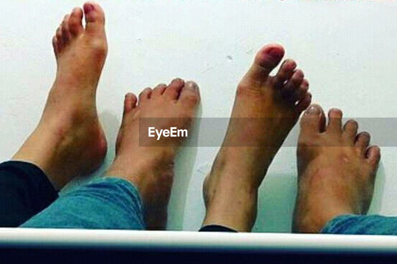 barefoot, low section, human leg, human foot, real people, human body part, personal perspective, togetherness, men, leisure activity, water, women, two people, indoors, day, bonding, close-up, adult, people, adults only