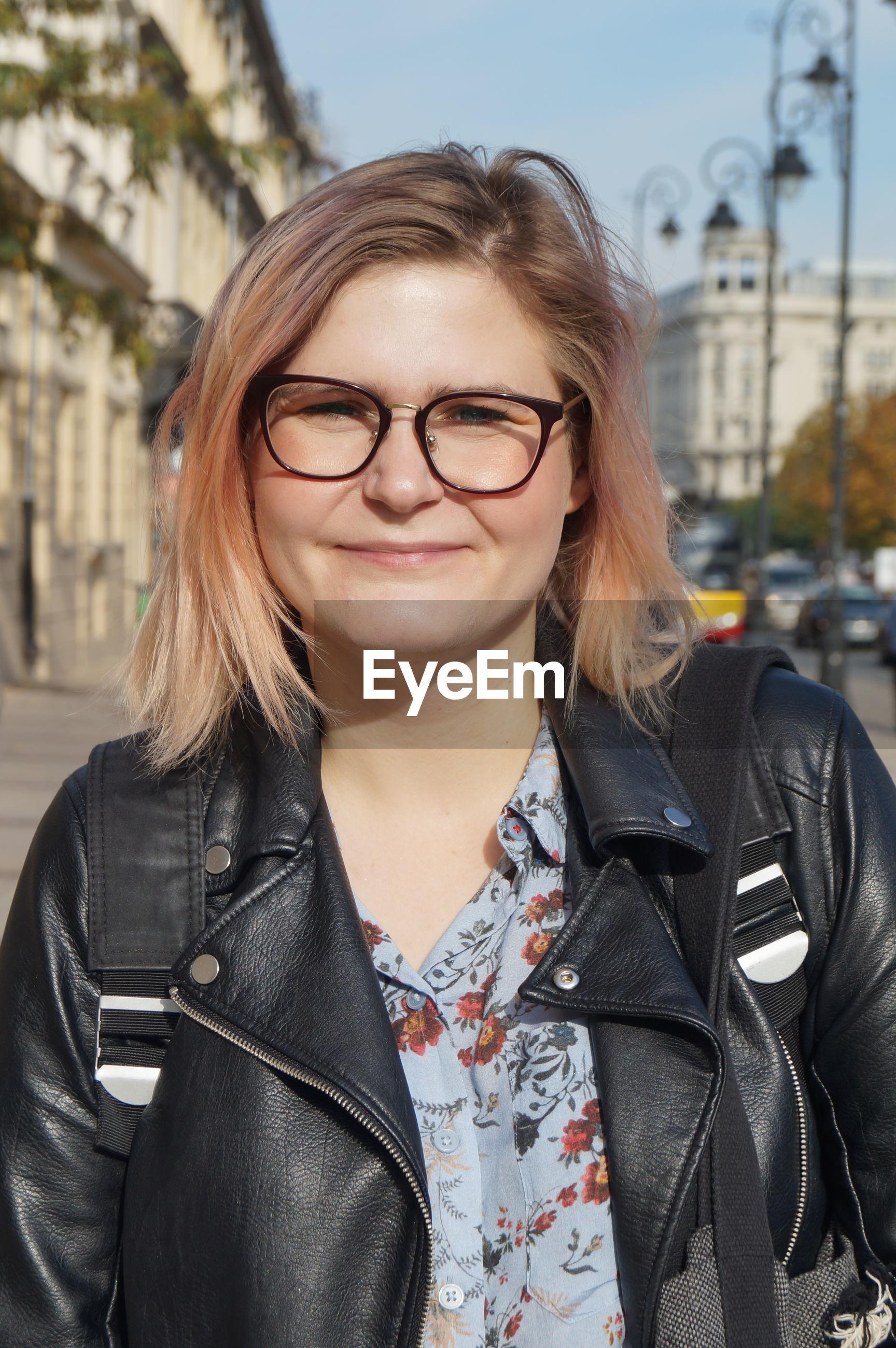 Portrait of smiling mature woman wearing eyeglasses