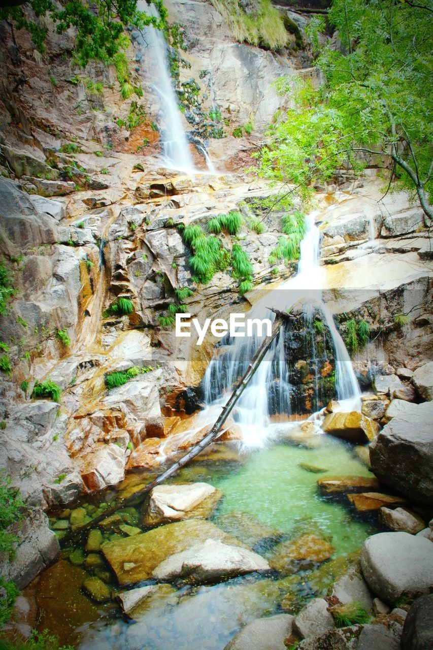 waterfall, motion, water, flowing water, long exposure, river, blurred motion, rock - object, rapid, nature, scenics, power in nature, beauty in nature, forest, no people, outdoors, speed, purity, adventure, mountain, day