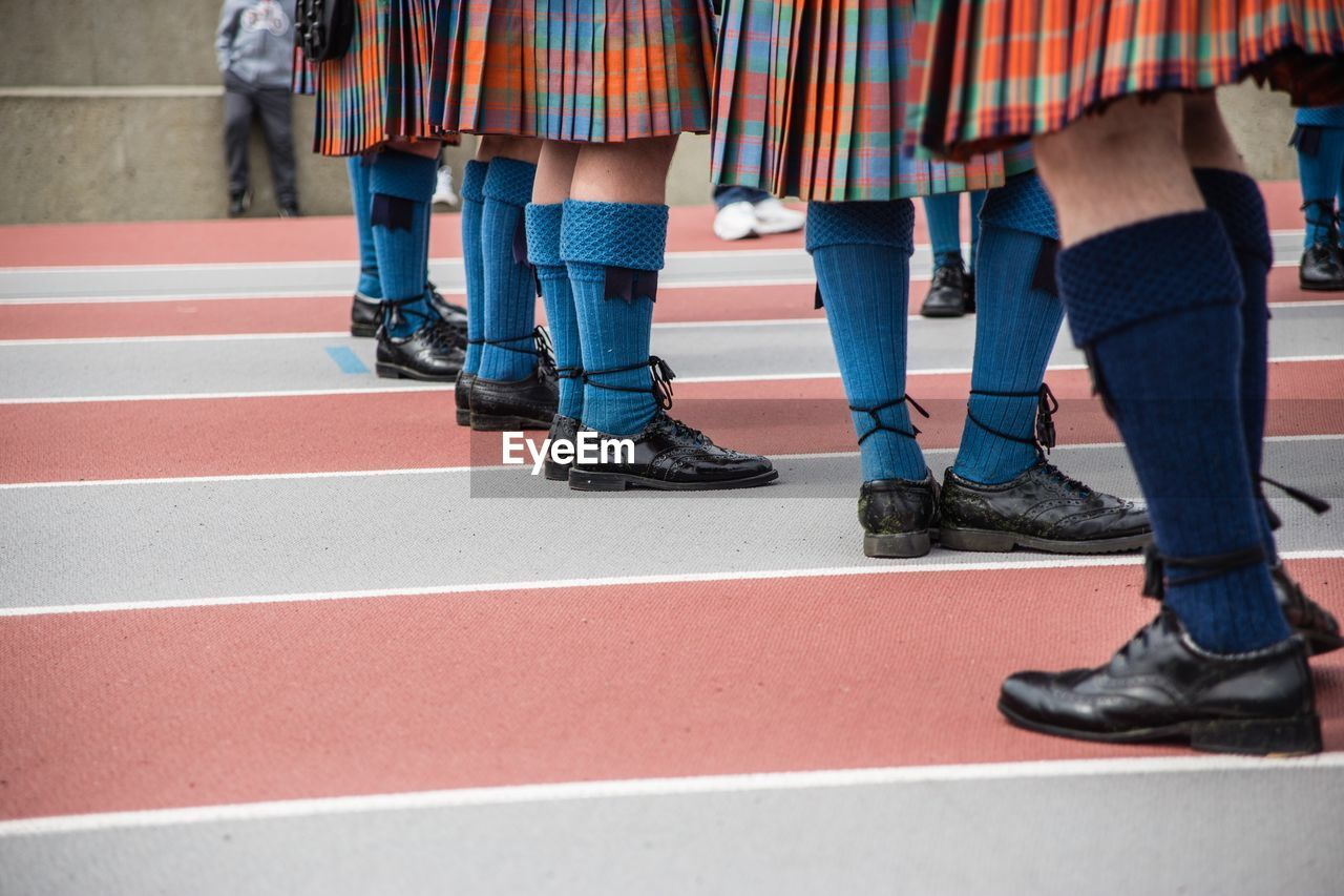 Low section of schoolgirls standing on ground