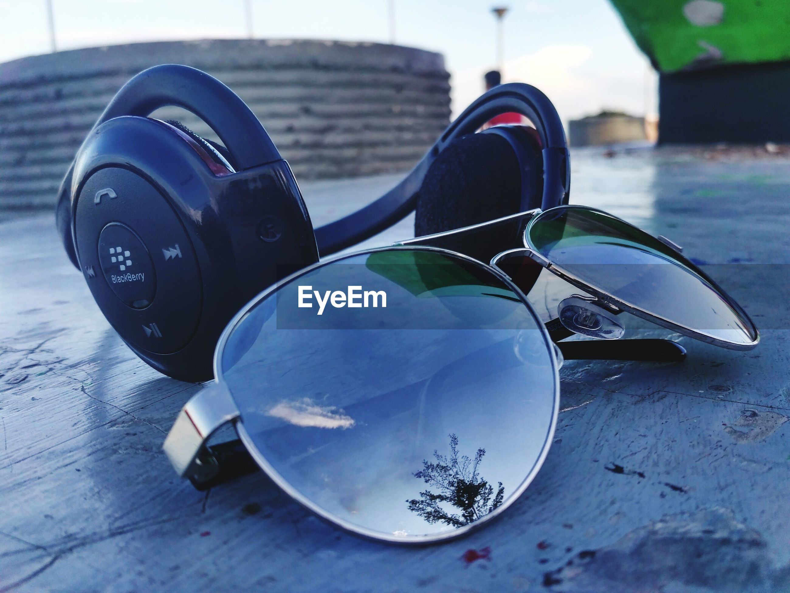 Close-up of sunglasses and headphones