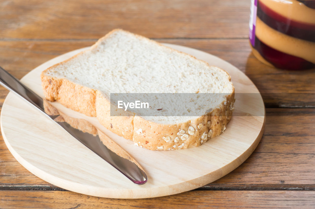 food and drink, table, food, wood - material, still life, bread, freshness, indoors, cutting board, no people, eating utensil, kitchen utensil, wellbeing, close-up, ready-to-eat, healthy eating, household equipment, high angle view, slice, plate, table knife, temptation