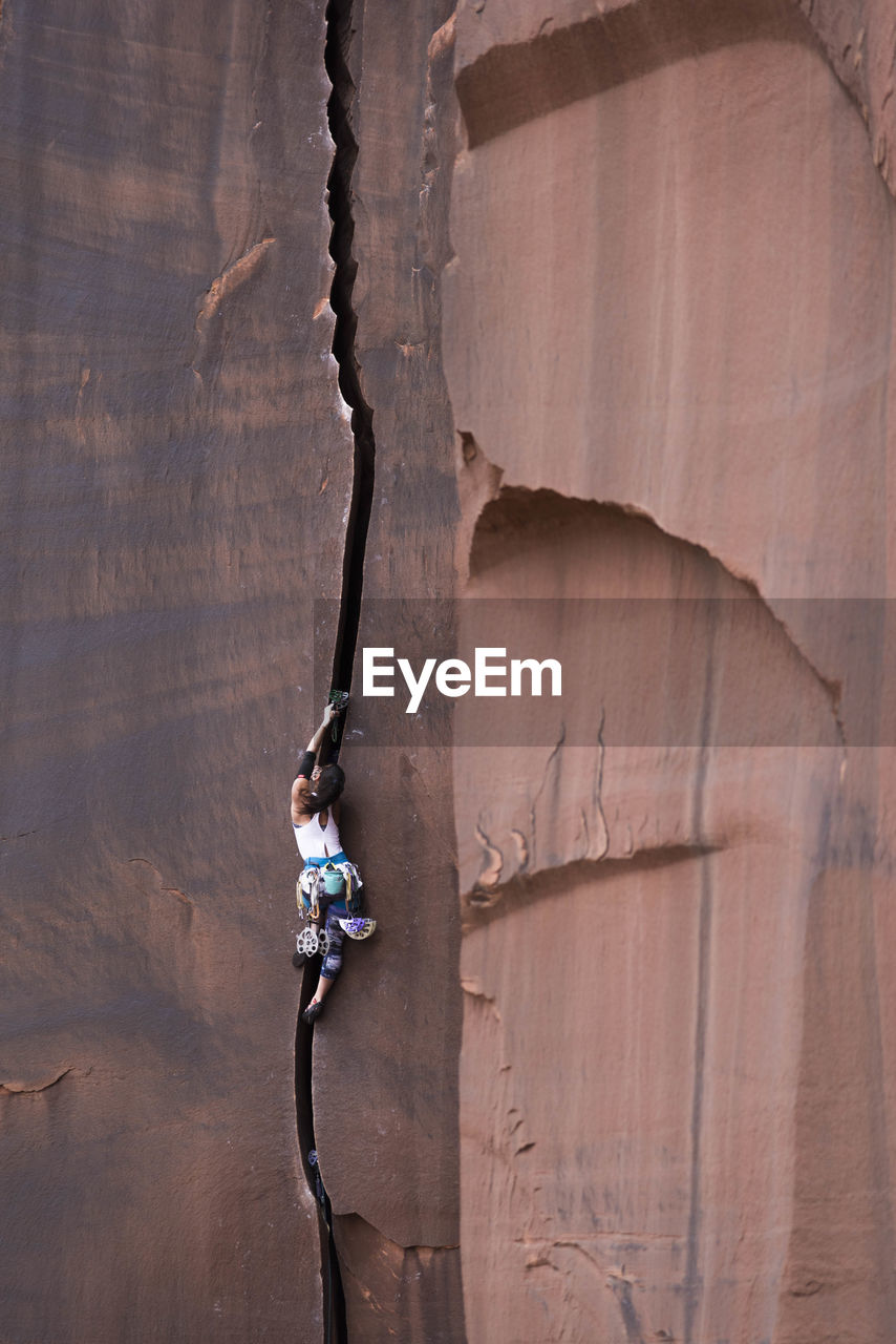 Low angle view of woman on rock formation
