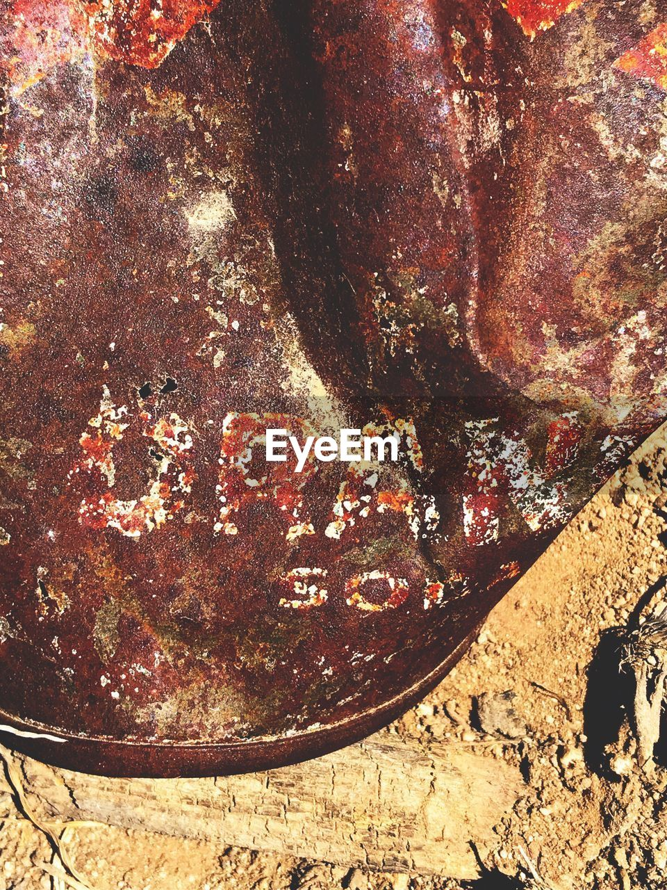 nature, no people, sunlight, day, close-up, high angle view, outdoors, metal, land, field, solid, rusty, old, textured, dirt, weathered, rock, still life, damaged, abandoned
