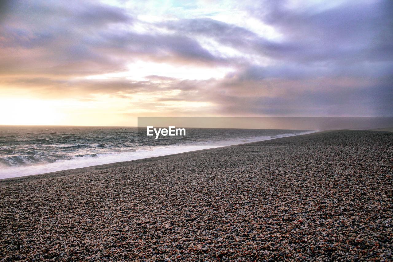 sky, sea, beach, cloud - sky, beauty in nature, water, scenics - nature, horizon, land, horizon over water, tranquility, tranquil scene, sunset, nature, no people, non-urban scene, sand, idyllic, pebble, outdoors