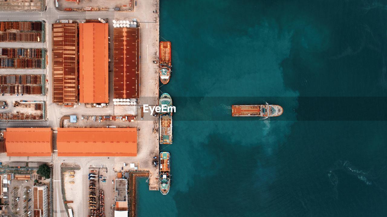 Aerial view of commercial dock by sea