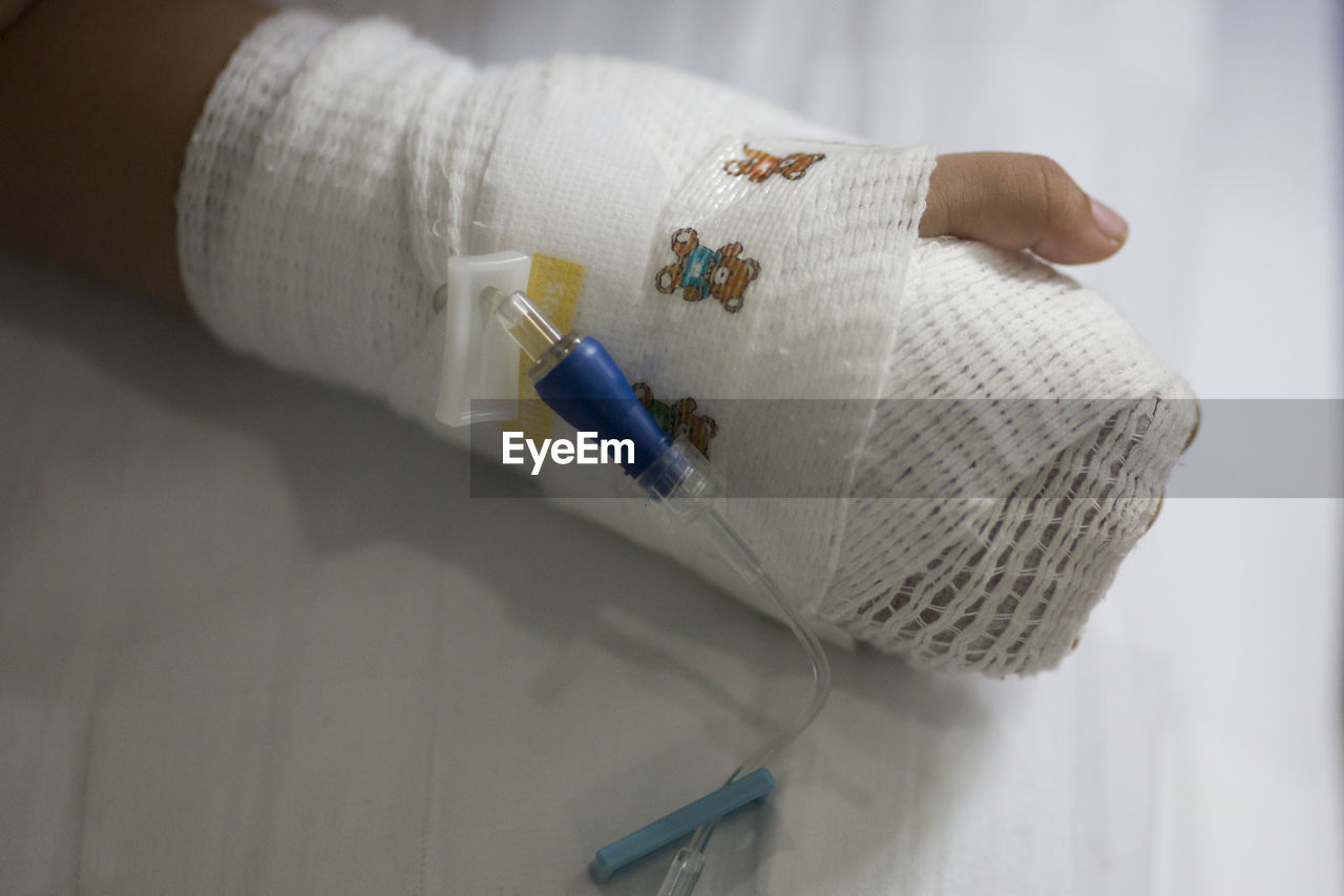 Midsection Of Person With Bandage On Hand