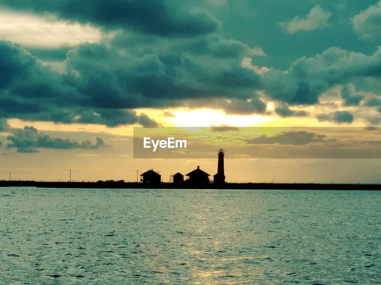 sky, cloud - sky, sunset, water, scenics - nature, beauty in nature, sea, silhouette, waterfront, nature, no people, tranquility, orange color, tranquil scene, architecture, built structure, idyllic, outdoors, sunlight, horizon over water