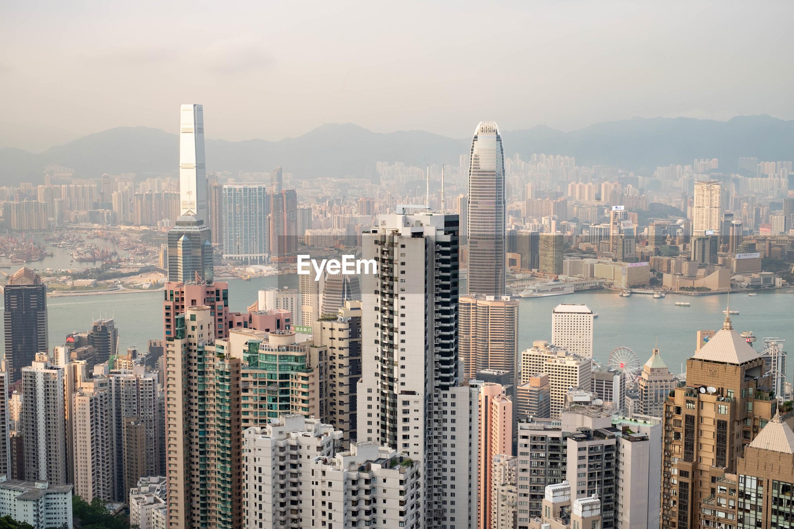 AERIAL VIEW OF MODERN BUILDINGS AGAINST SKY IN CITY