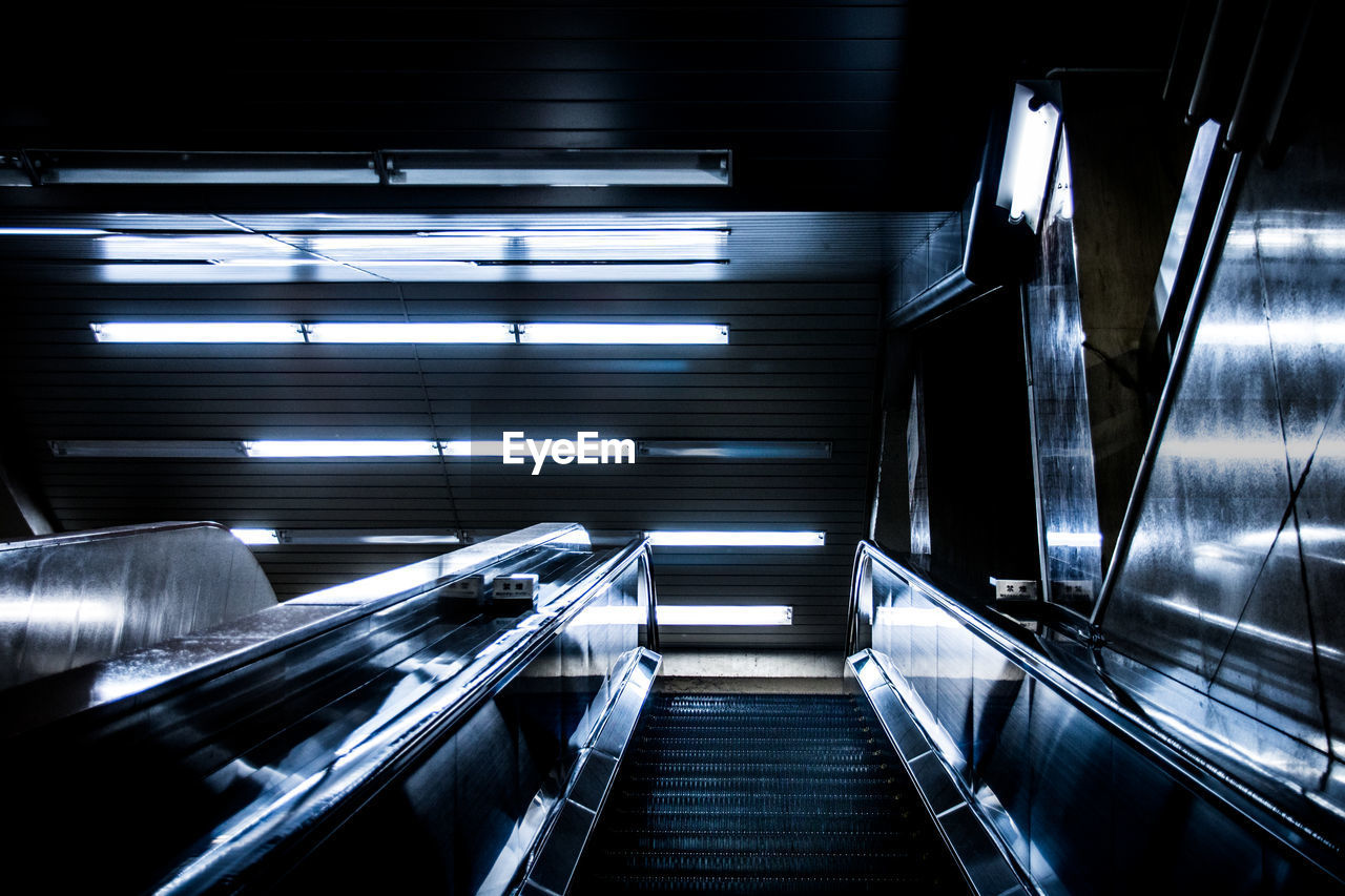 Low Angle View Of Escalator In Illuminated Building