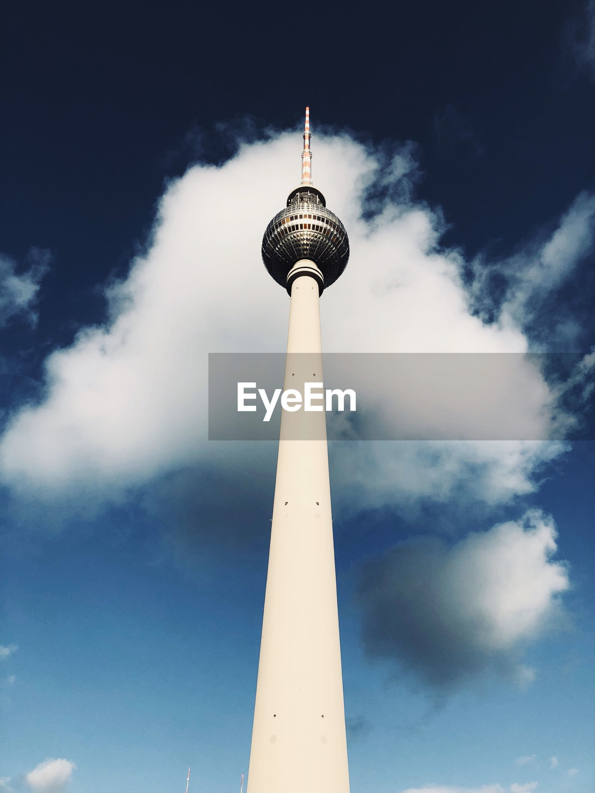tall - high, architecture, communication, spire, low angle view, tower, built structure, television tower, sky, travel destinations, building exterior, outdoors, tourism, travel, no people, city, day