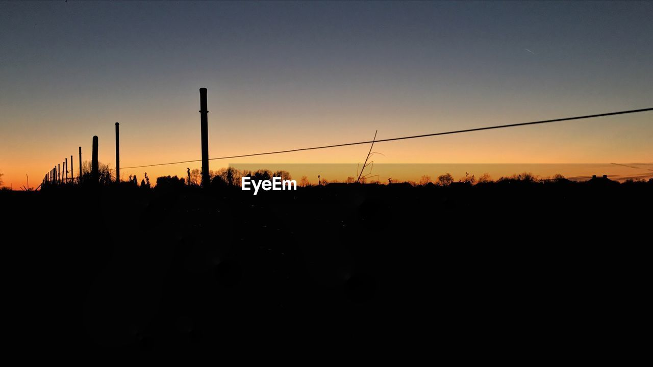 sunset, silhouette, orange color, nature, copy space, clear sky, sky, no people, scenics, tranquility, beauty in nature, outdoors, industry, tree, day