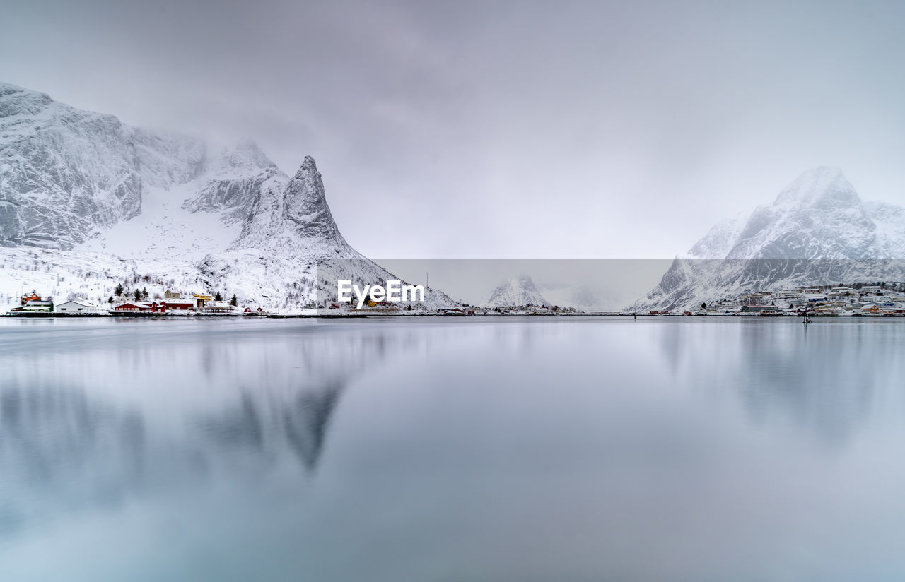 mountain, cold temperature, winter, water, scenics - nature, beauty in nature, snow, sky, mountain range, snowcapped mountain, lake, waterfront, cloud - sky, nature, tranquil scene, tranquility, no people, day