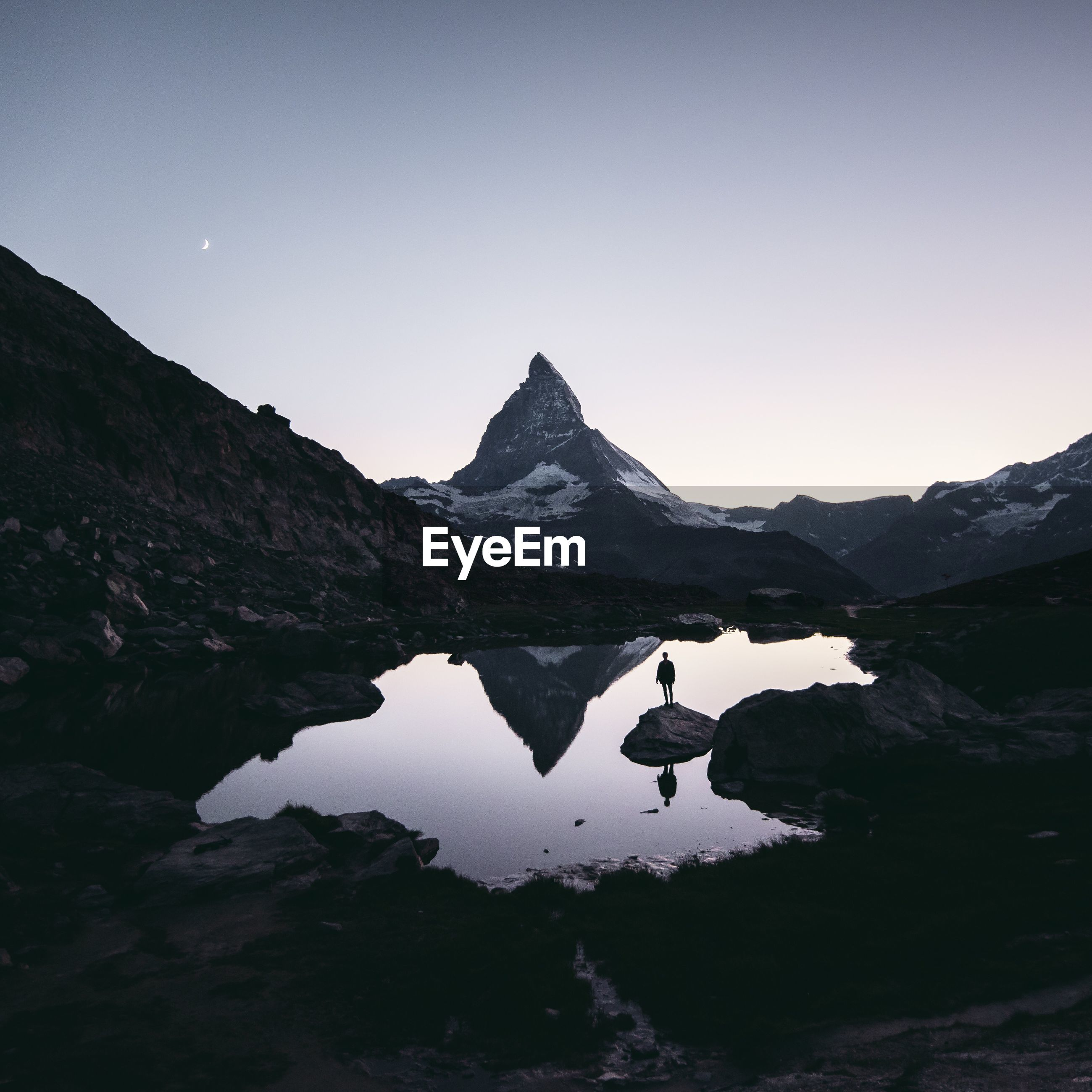 mountain, reflection, landscape, lake, mountain range, beauty in nature, water, nature, scenics, adventure, sky, outdoors, mountain peak, night, people, one person, star - space