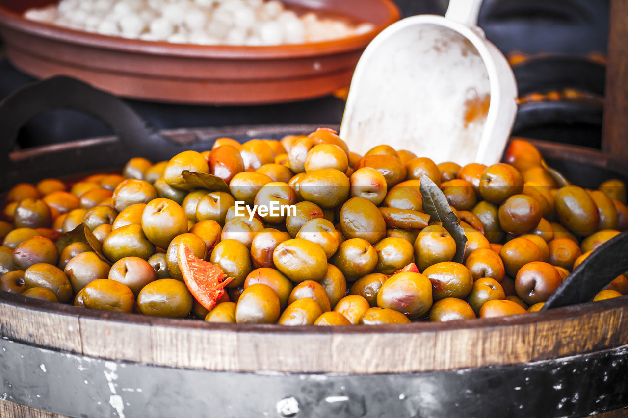 food, freshness, food and drink, container, still life, healthy eating, wellbeing, no people, focus on foreground, large group of objects, close-up, kitchen utensil, market, market stall, fruit, indoors, selective focus, for sale, day, table