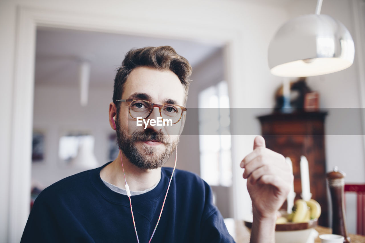 beard, focus on foreground, real people, facial hair, indoors, one person, portrait, front view, headshot, casual clothing, looking at camera, eyeglasses, lifestyles, glasses, mid adult, men, adult, mid adult men, hairstyle