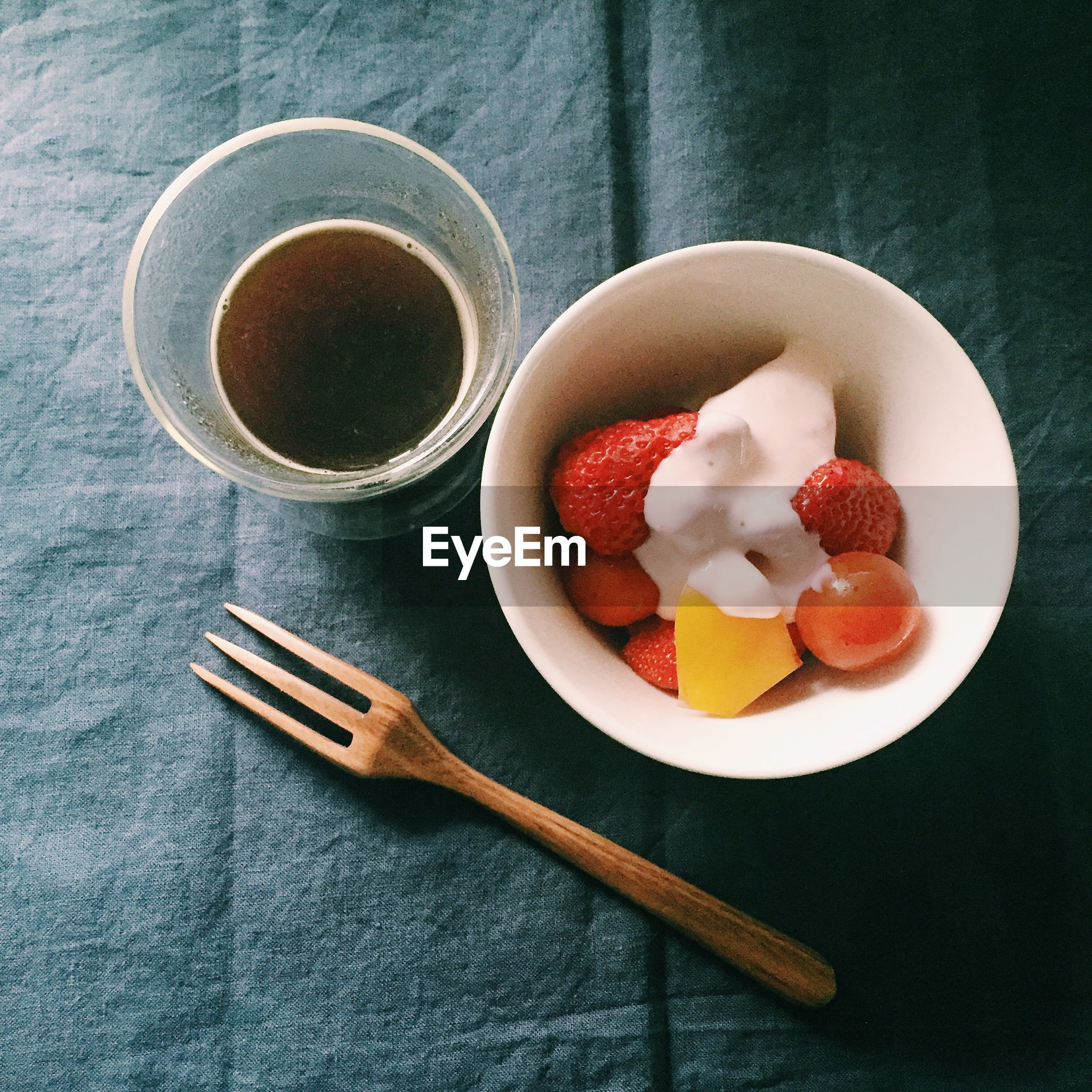 Directly above shot of coffee and fruit salad bowl on table