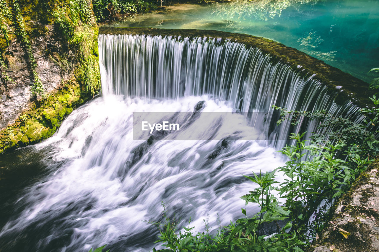 water, motion, waterfall, flowing water, long exposure, beauty in nature, scenics - nature, blurred motion, flowing, nature, plant, environment, tree, no people, sea, forest, aquatic sport, power, power in nature, outdoors, rainforest, running water, falling water