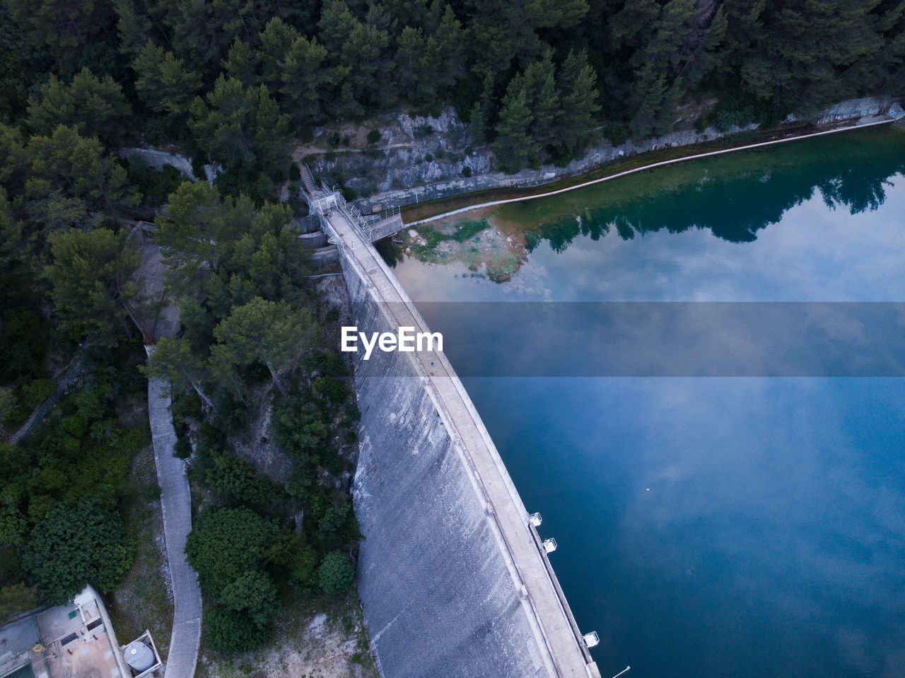 tree, water, scenics - nature, architecture, nature, high angle view, beauty in nature, built structure, plant, day, no people, dam, mountain, hydroelectric power, bridge, travel destinations, transportation, connection, tranquil scene, bridge - man made structure, outdoors, power in nature