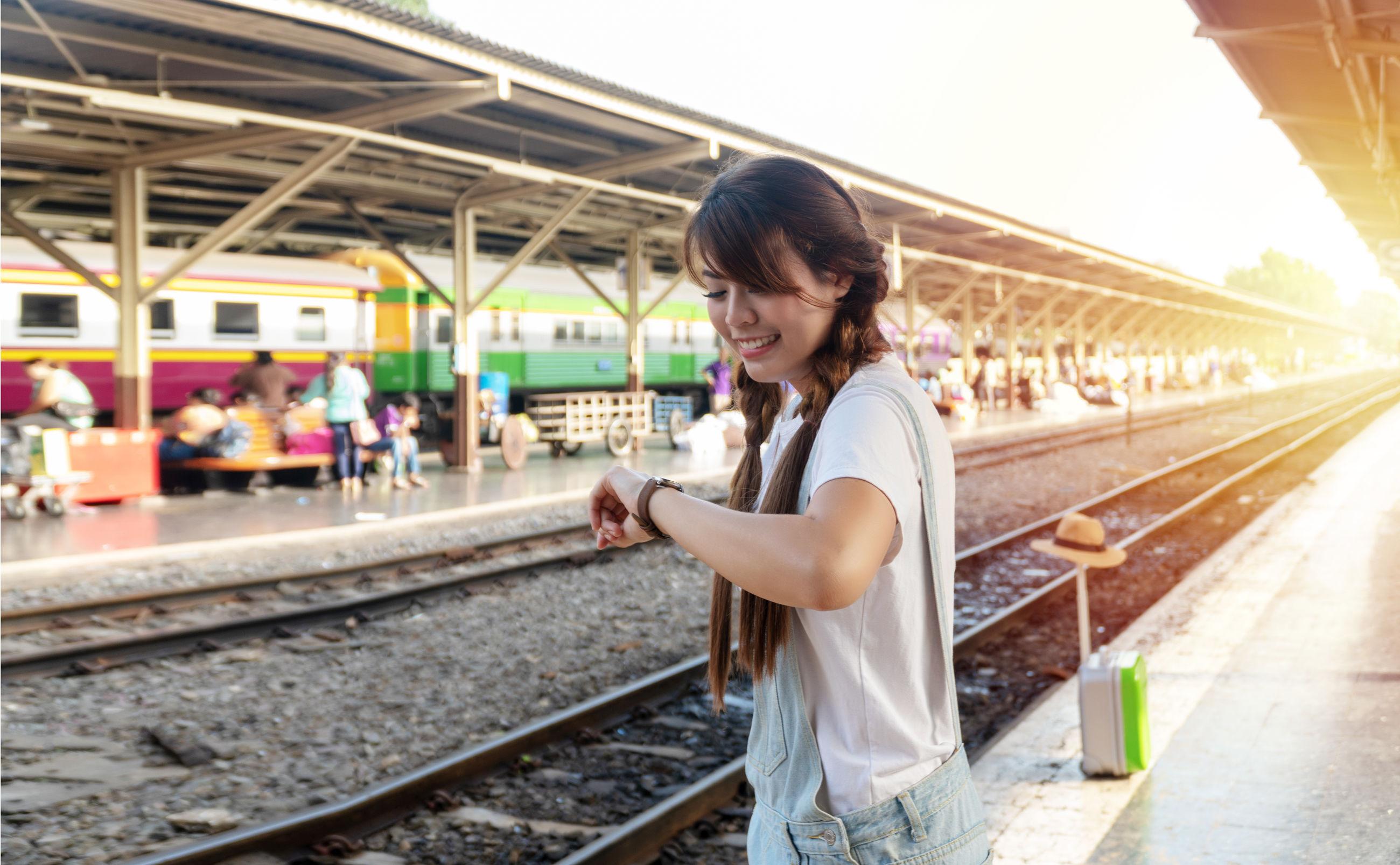 Woman checking time at railroad station platform