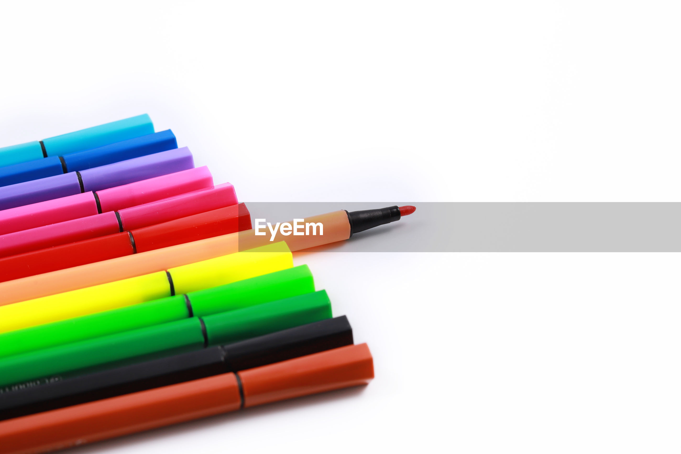 Close-up of colorful felt tip pens on white background