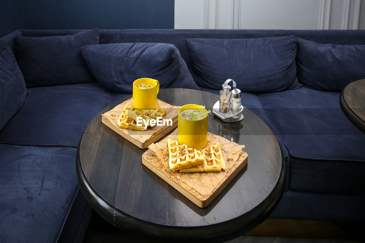 food and drink, food, sofa, freshness, table, indoors, no people, ready-to-eat, furniture, drink, refreshment, snack, still life, household equipment, glass, high angle view, unhealthy eating, drinking glass, prepared potato, potato, tray, temptation, breakfast