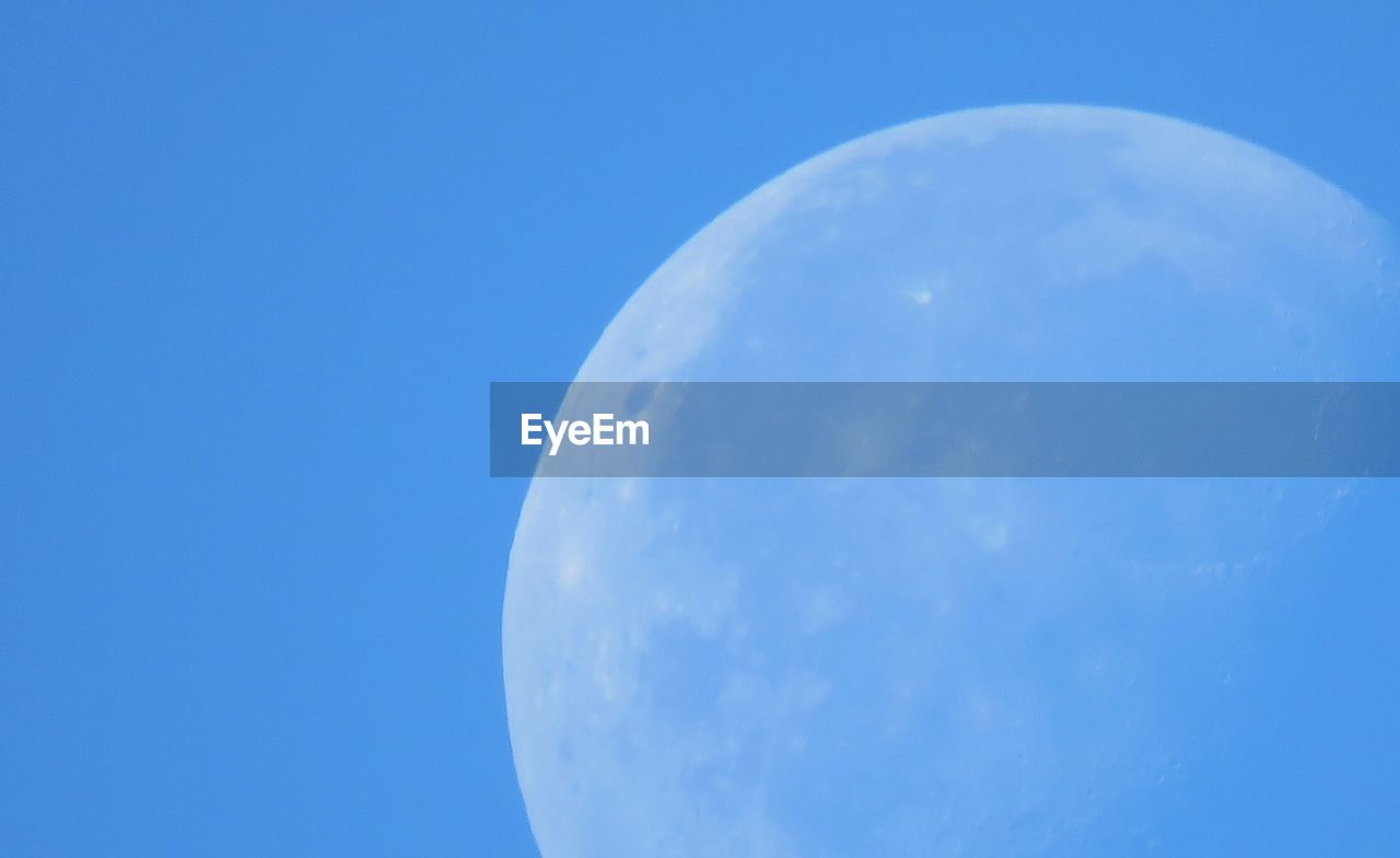 blue, circle, moon, no people, low angle view, beauty in nature, nature, sky, moon surface, close-up, outdoors, clear sky, day, astronomy, space