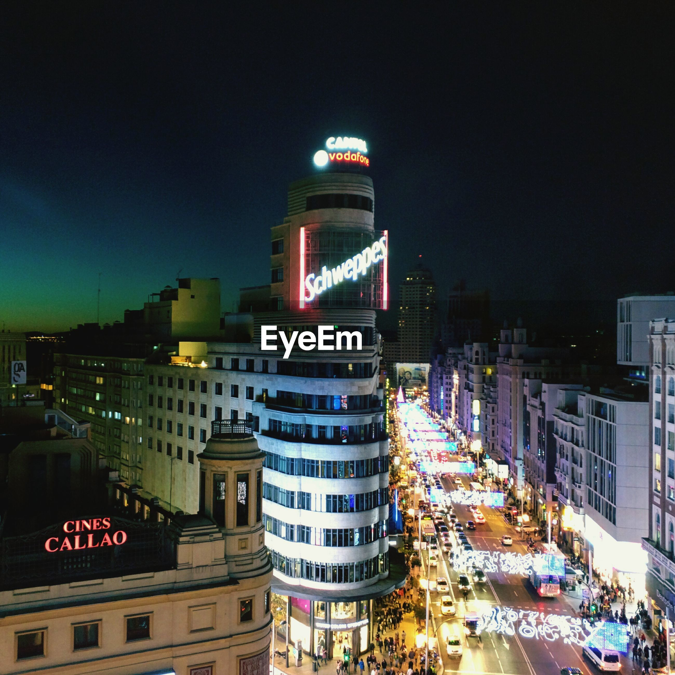 building exterior, architecture, built structure, illuminated, city, night, city life, street, building, sky, car, city street, residential building, transportation, skyscraper, street light, cityscape, office building, modern, outdoors