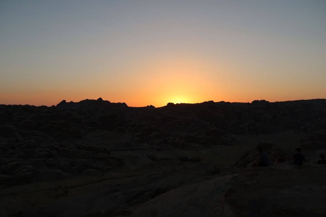sunset, landscape, nature, tranquil scene, orange color, no people, tranquility, beauty in nature, barren, scenics, outdoors, arid climate, silhouette, desert, sky, clear sky, mountain, day