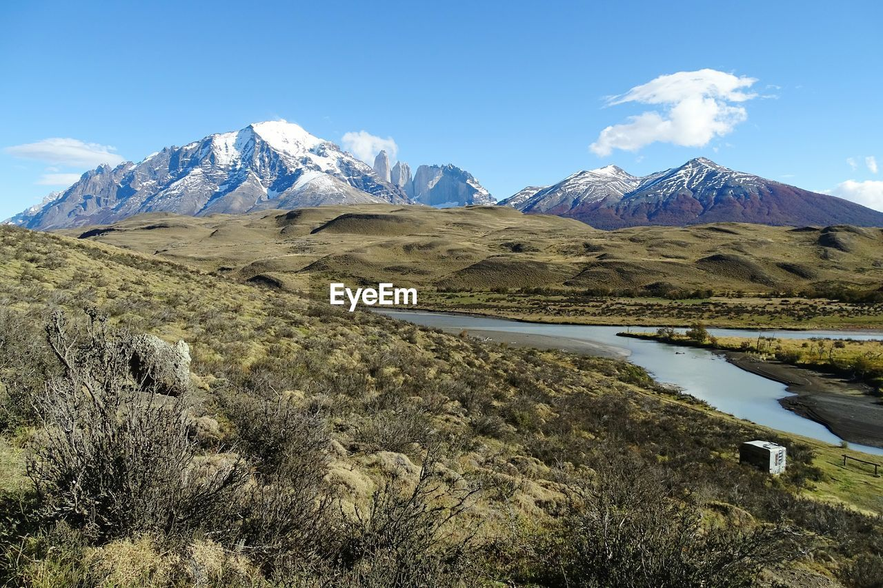 Scenic View Of Lake And Mountains At Torres Del Paine National Park