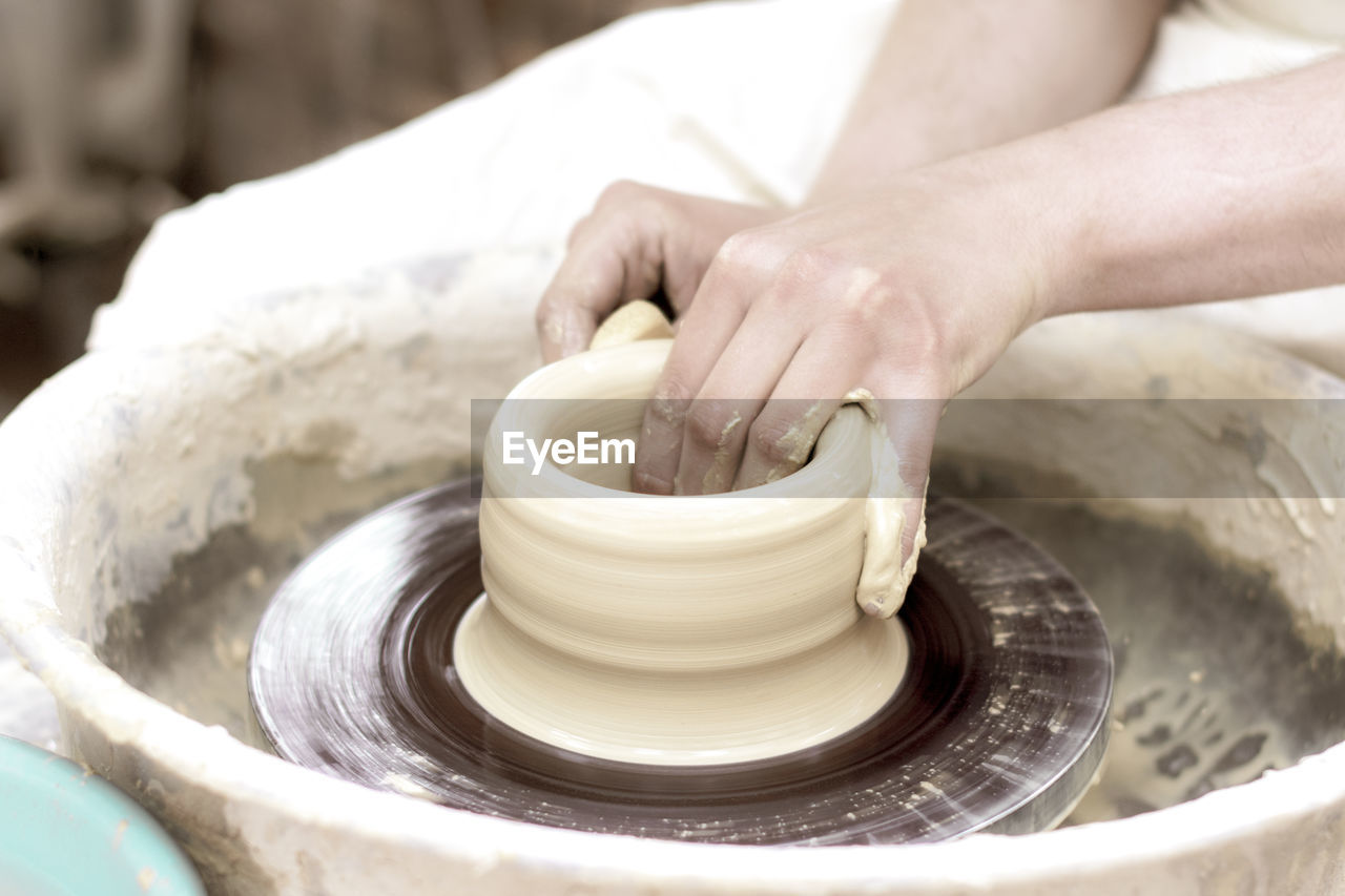 skill, hand, human hand, pottery, craft, spinning, molding a shape, making, clay, art and craft, motion, working, creativity, expertise, one person, occupation, human body part, unrecognizable person, real people, indoors, preparation, mud, finger