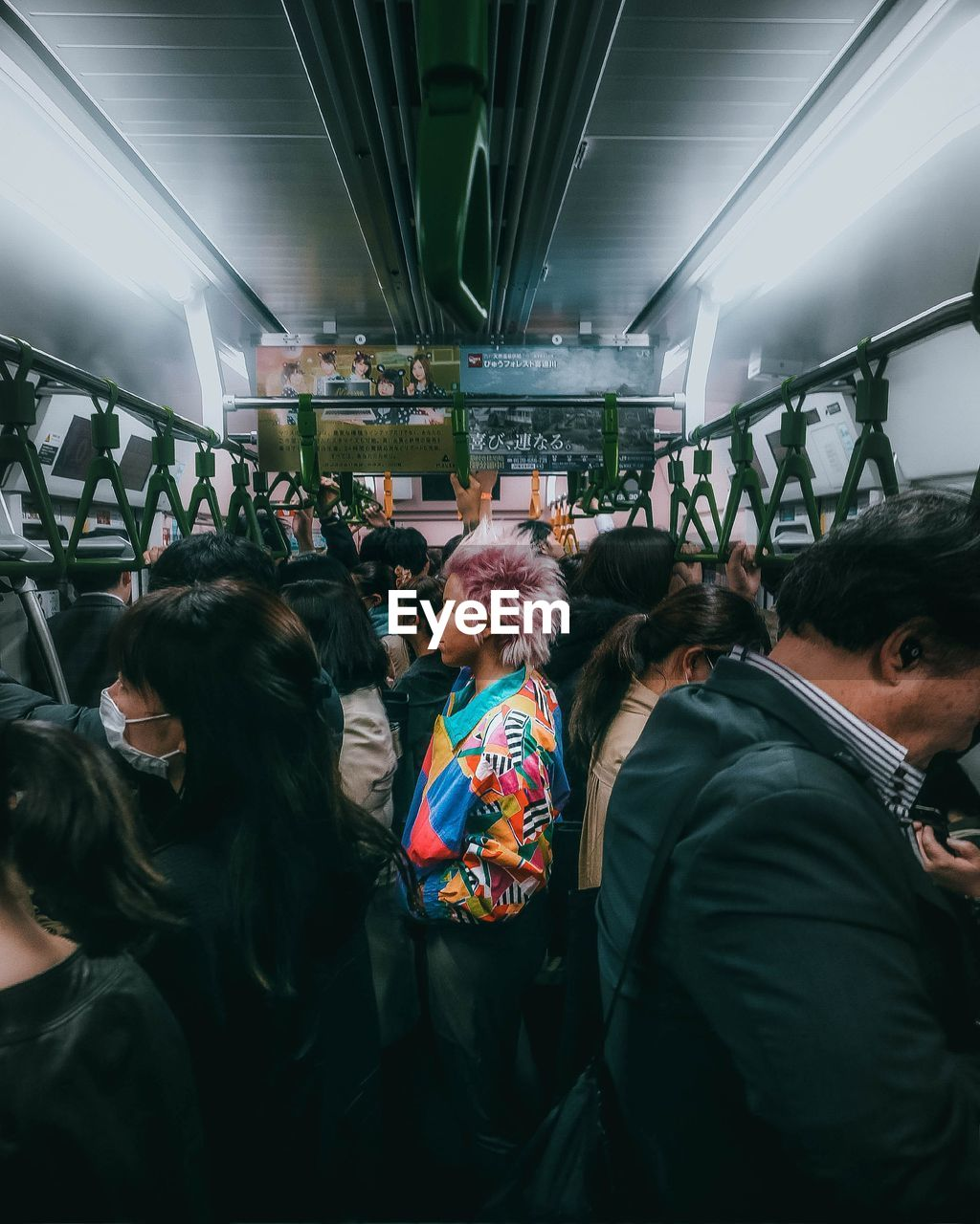 group of people, real people, large group of people, women, crowd, adult, lifestyles, men, leisure activity, rear view, indoors, public transportation, transportation, architecture, togetherness, casual clothing, standing, illuminated, ceiling