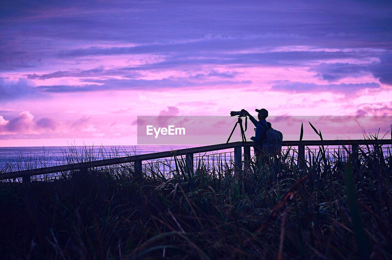 Man Photographing At Sea