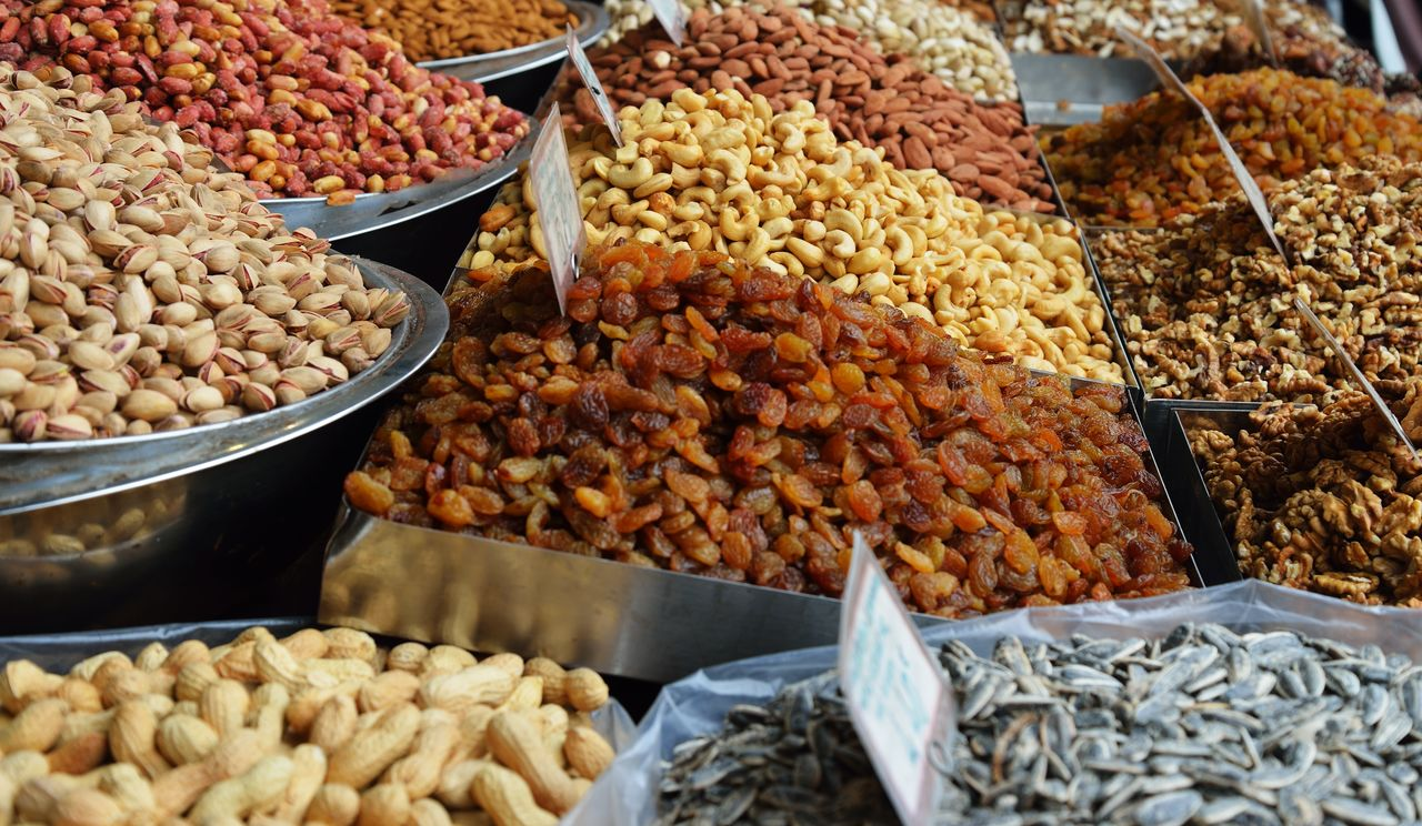 food and drink, food, market, retail, large group of objects, choice, market stall, for sale, freshness, wellbeing, variation, no people, healthy eating, abundance, still life, nut, dried fruit, container, nut - food, dried food, sale, snack
