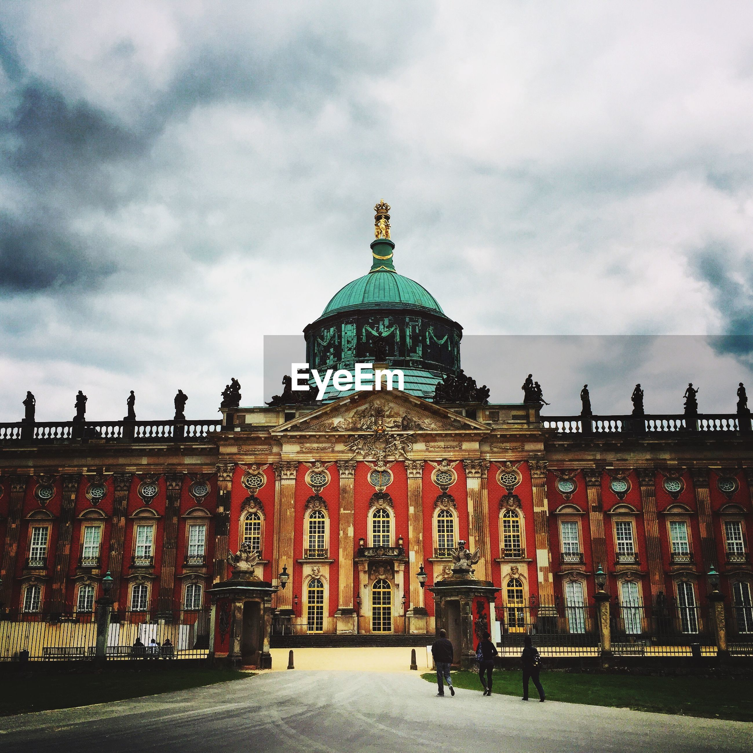 View of new palace potsdam against cloudy sky
