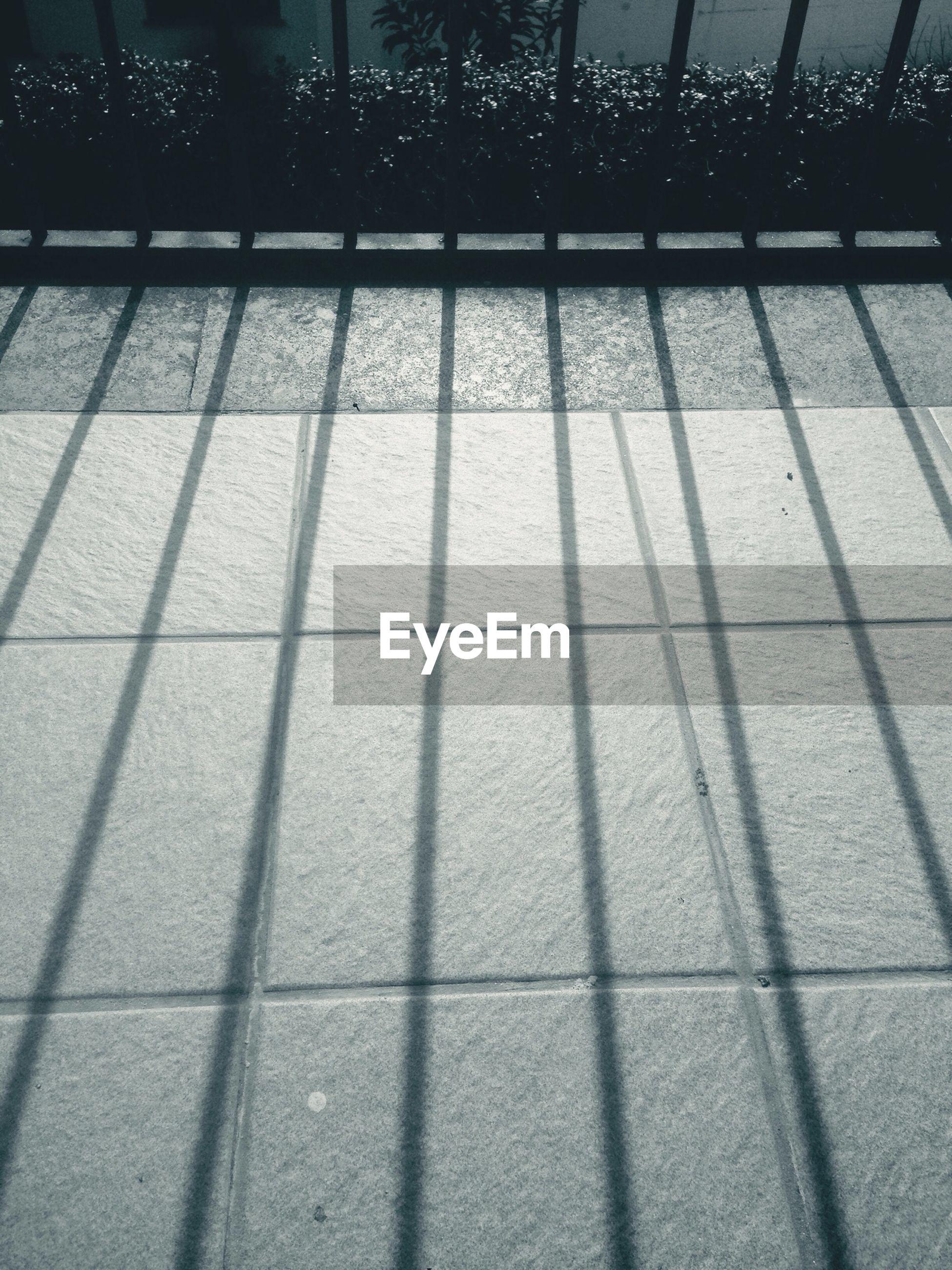 Shadow of fence on floor