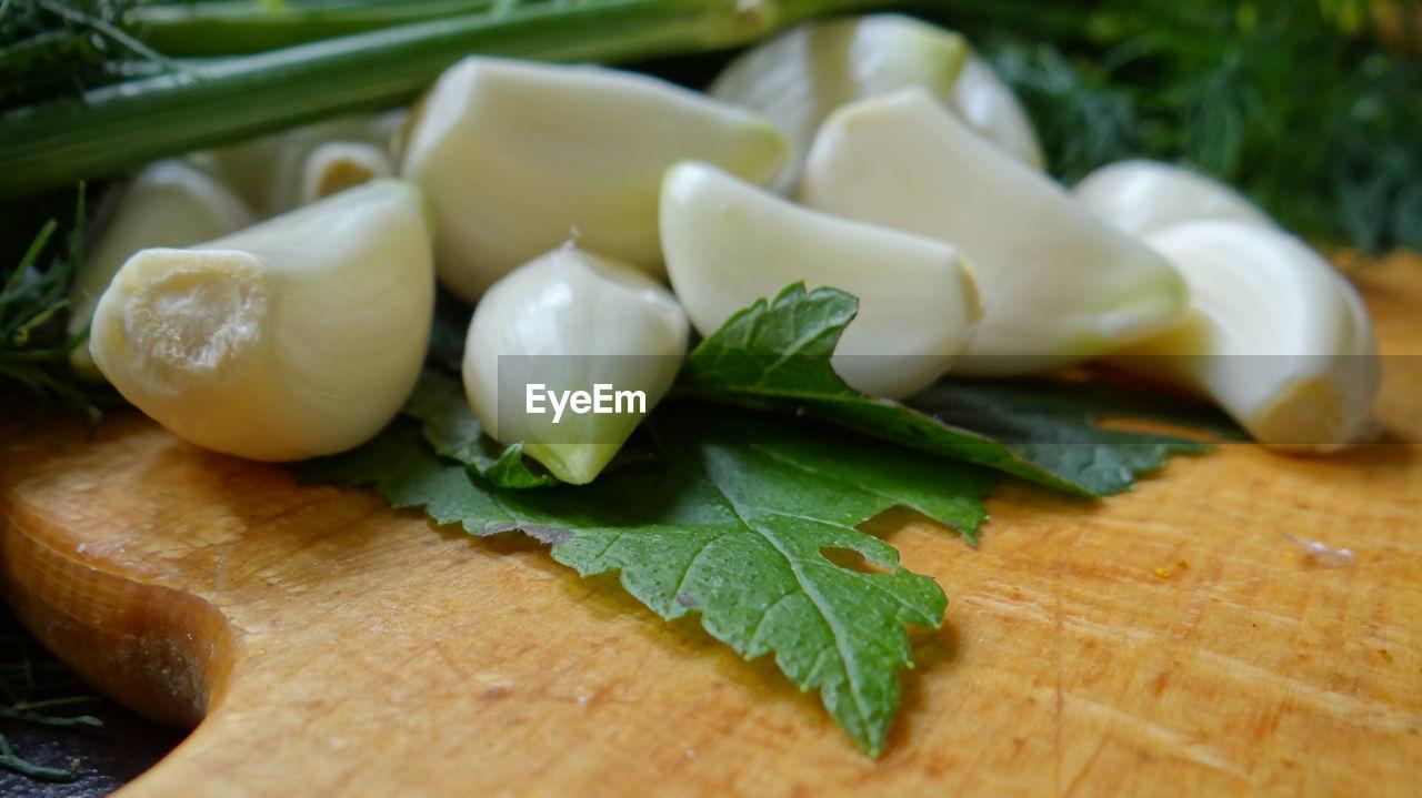 Close-Up Of Garlic On Cutting Board