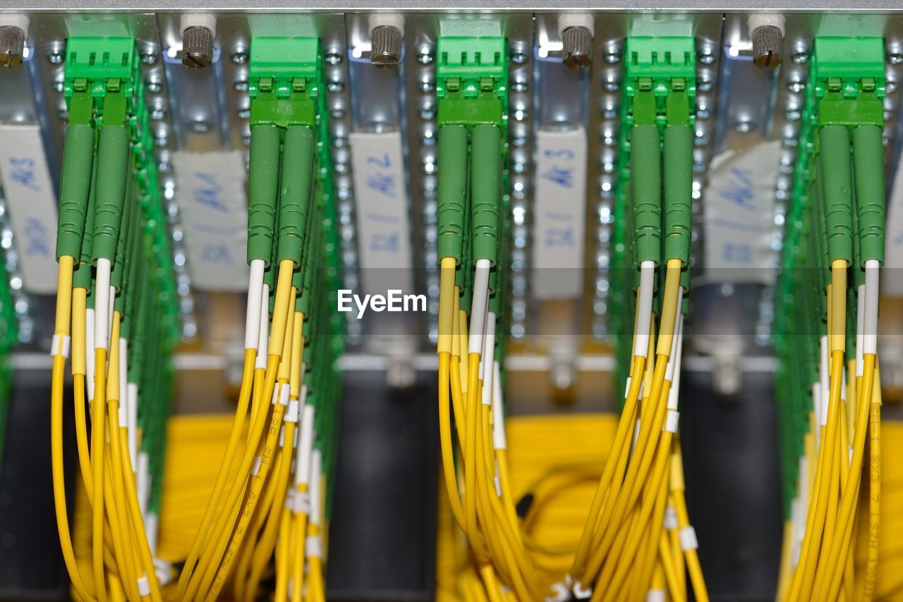 green color, close-up, technology, indoors, connection, no people, yellow, communication, focus on foreground, cable, full frame, computer network, equipment, side by side, large group of objects, in a row, internet, wireless technology, multi colored, order, network server, complexity