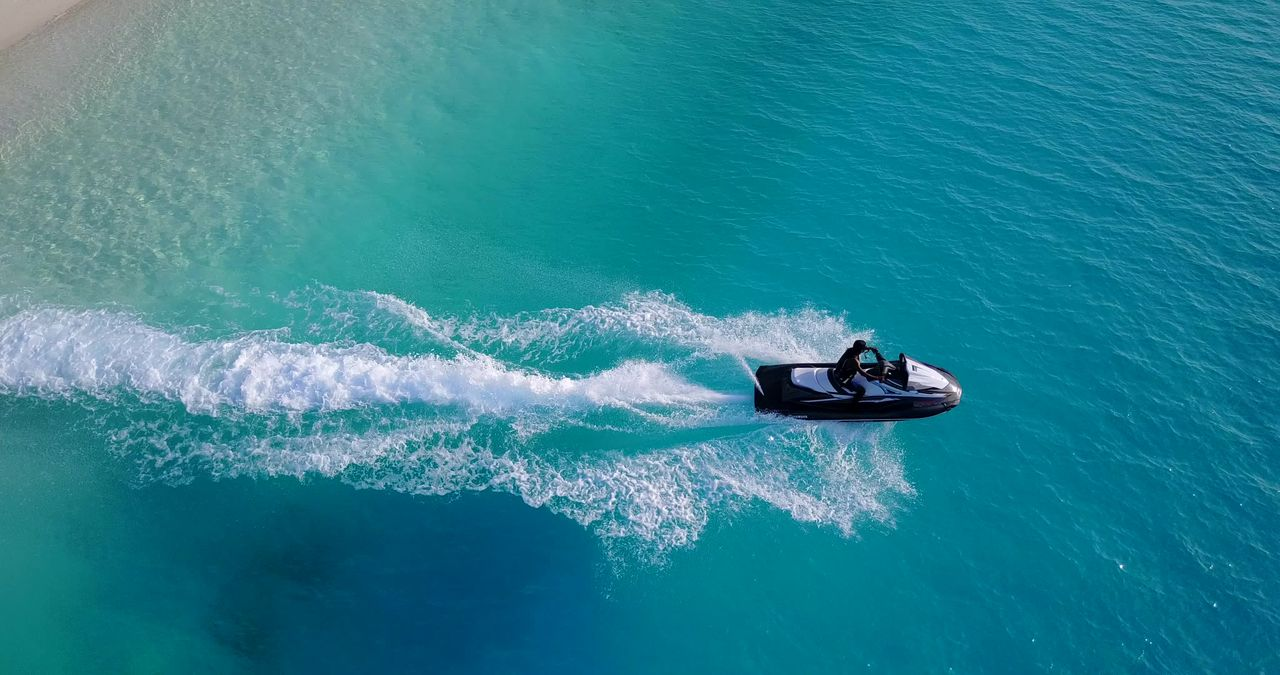 High Angle View Of Man On Jet Ski In Sea