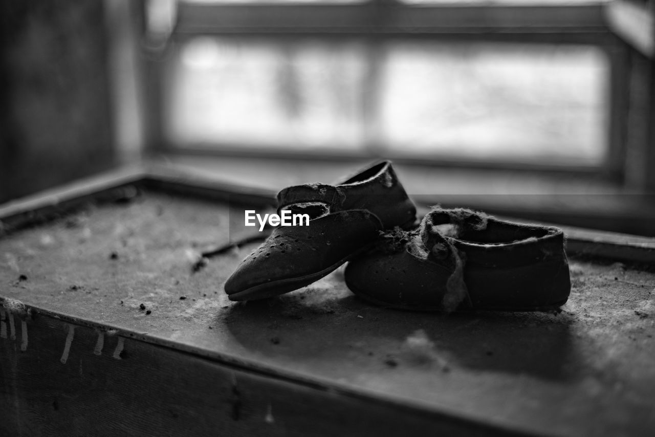 Close-up of child's shoes on  table in pripyat