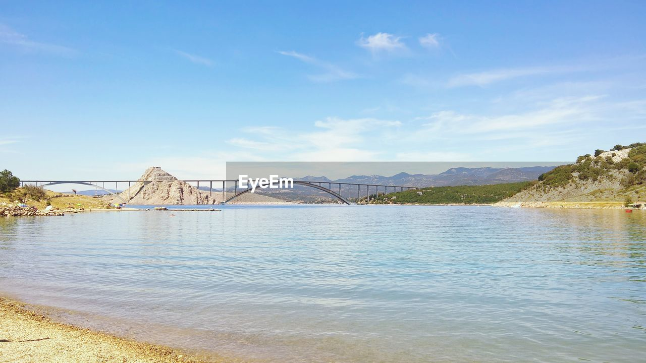 water, bridge, built structure, sky, architecture, bridge - man made structure, connection, nature, river, day, waterfront, transportation, no people, scenics - nature, beauty in nature, tranquil scene, cloud - sky, tranquility, arch, arch bridge, outdoors, bay