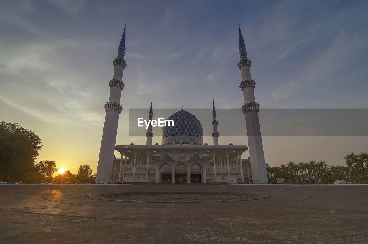 Low angle view of blue mosque against sky during sunset